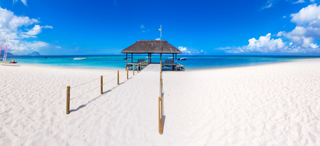 beach panorama: Sandy tropical Wolmar beach at sunny day. Jetty on the foreground.  Mauritius. Panorama