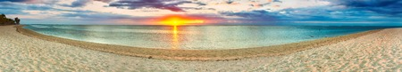 White sandy beach Le Morne at sunset. Mauritius. Panorama