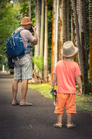 Father and son at botanical garden. Mauritius photo