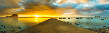 Sunset over sea. Le Morn Brabant on background. Mauritius. Panorama Stock Photo