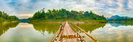 Beautiful view of a bamboo bridge. Luang Prabang. Laos landscape. Panorama