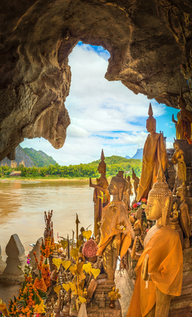 View from the Pak Ou cave. Buddha statue on the foreground. Luang Prabang. Laos.