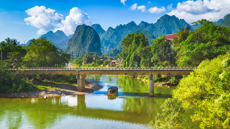 Amazing landscape of Nam Song river among mountains. Bridge on the foreground. Pha Tang, Vang Vieng district, Laos. Panorama Stock Photo