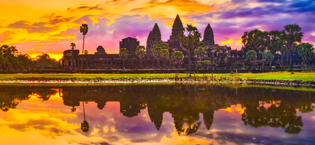 Angkor Wat temple reflecting in water of  Lotus pond at sunrise. Siem Reap. Cambodia. Panorama