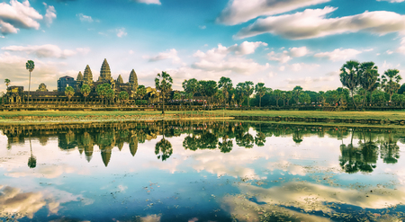 Angkor Wat temple reflecting in water of  Lotus pond at sunset. Siem Reap. Cambodia. Panorama