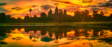 Angkor Wat temple reflecting in water of Lotus pond at sunrise. Siem Reap. Cambodia. Panorama