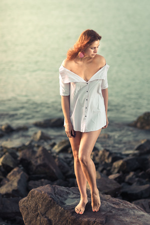 Portrait of a beautiful sexy woman outdoor. Model near the sea