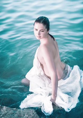 Portrait of a beautiful woman outdoor. Bather in the sea Banco de Imagens