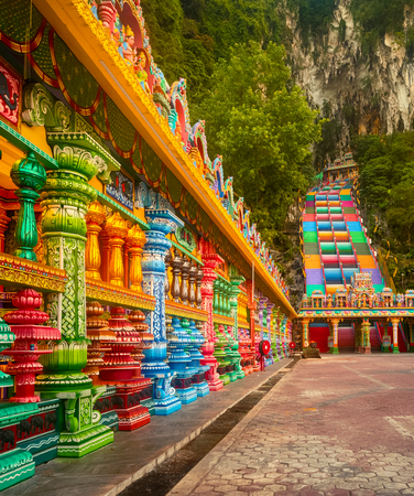 Beautiful view of colorful stairs of Batu caves. Malaysia
