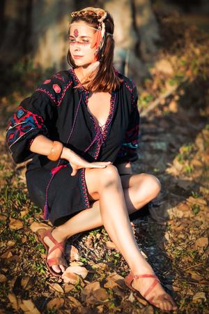 Portrait of a beautiful ethnic woman posing outdoor. Creative makeup Stock Photo