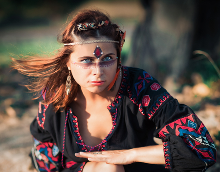 Portrait of a beautiful ethnic woman posing outdoor. Creative makeup Archivio Fotografico