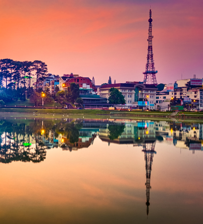Amazing view of sunrise over Xuan Huong Lake, Dalat, Vietnam. Cityscape photo.