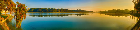 Amazing view of sunrise over Xuan Huong Lake, Dalat, Vietnam. Panorama Banco de Imagens