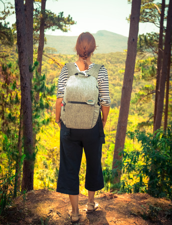 Tourist with backpack in highland, Dalat, Vietnam
