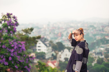 Beautiful woman overlooking the city view, Dalat, Vietnam
