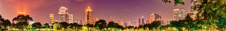Panoramic view of Bangkok skyline. Night cityscape of Bangkok, Thailand. View from Lumphini park Фото со стока