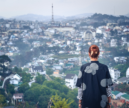 Beautiful woman overlooking the city view, Dalat, Vietnam