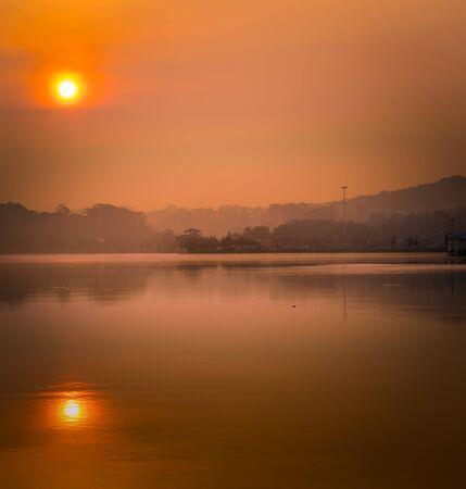 Amazing view of sunrise over Xuan Huong Lake, Dalat, Vietnam. Panoramic landscape at sunrise time