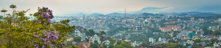 Vietnams littel Paris Da Lat cityscape. Copy of Eiffel tower on background. View from the mountain of Dalat, Vietnam. High resolution panorama Stock Photo
