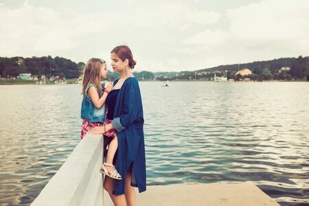 Mother and daughter enjoying at Xuan Huong Lake, Dalat, Vietnam