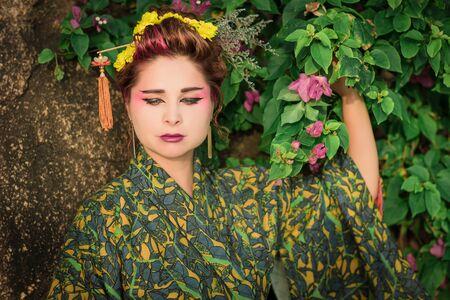 Fine art portrait of beautiful woman in Japanese Geisha style wearing kimono Stok Fotoğraf