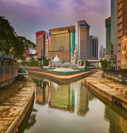 Kuala Lumpur cityscape at sunset, River of the Life on the foreground, Malaysia.  Фото со стока