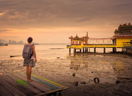 Tourist  at Yeoh jetty at sunrise, Georgetown, Penang, Malaysia.