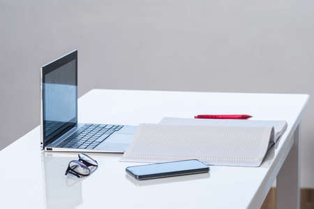 Set for online work or education, laptop, notebook, smartphone on a table