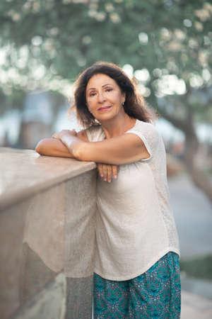 Outdoor portrait of a beautiful smiling senior woman 免版税图像