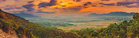 Beautiful landscape view of rice field and mountains at sunset. Panorama 免版税图像