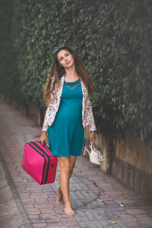 Outdoor portrait of a beautiful pregnant woman 免版税图像