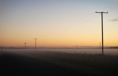 Misty outback road, Queensland Australia photo