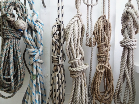 knotting: Ropes hanging up on board boat.