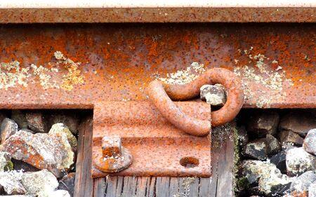 sleeper: Close up of railway line showing steel rail and sleeper