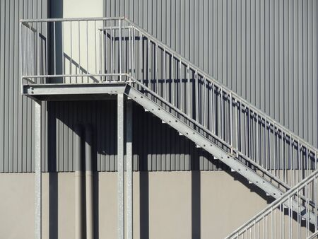 steel: Steel stairs on side of building in sunlight