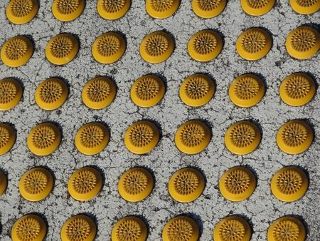 non skid: Row of tactile paving domes in parking lot Stock Photo