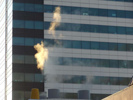 vapour: Steam rising from buildings, Wellington New Zealand