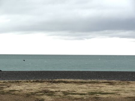 sombre: Napier New Zealand seafront with beach, sea and sky.