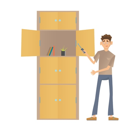 Young man assembling a cupboard. Stock Photo