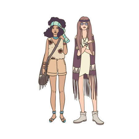 Two young hippie women dressed in stylish clothing decorated with fringe and ethnic ornaments standing together. Beautiful female cartoon characters isolated on white background. Vector illustration. Illustration