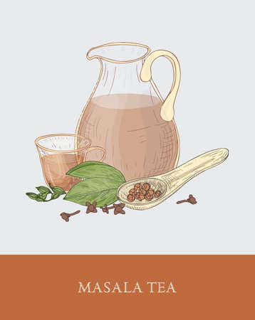 Glass jug, cup of masala chai or traditional spiced Indian tea, spoon, cardamon and cloves on gray background.