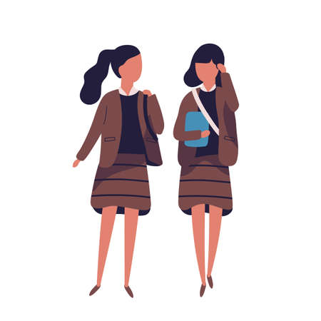 Pair of girls dressed in school uniform. Female students, pupils, classmates, schoolfellows walking together and talking to each other or chatting. Colored vector illustration in modern flat style Foto de archivo - 117296720