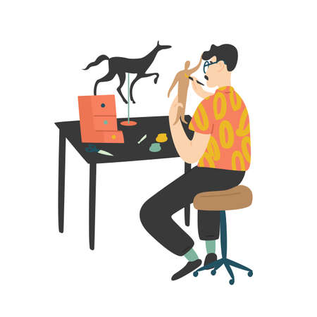 Young man sitting at desk and painting handcrafted miniature paper model figures isolated on white background. Male character enjoying his hobby at home. Flat cartoon colorful vector illustration Ilustración de vector