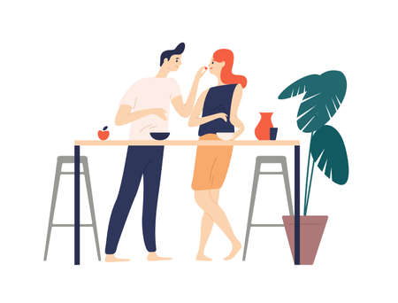Smiling man and woman standing in kitchen, eating snacks and feeding each other. Happy boy and girl having breakfast lunch. Cute couple enjoying food together. Flat cartoon vector illustration