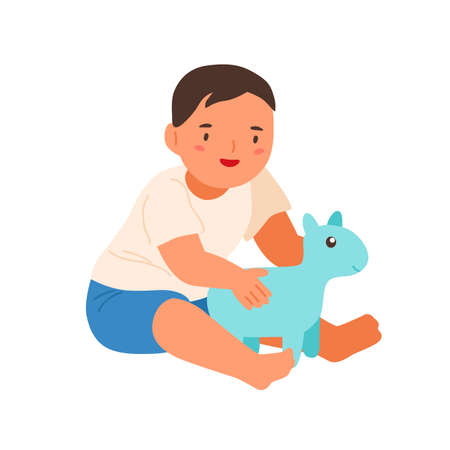 Cute smiling child playing with soft toy vector flat illustration. Happy little boy sitting hugging plaything isolated on white background. Adorable baby enjoying childhood having positive emotion Illustration