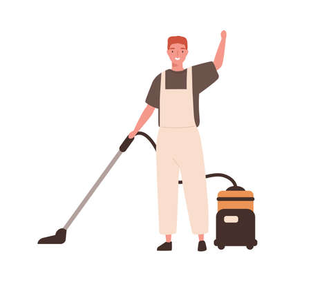 Young cheerful man in office cleaning service, janitor uniform vacuuming.