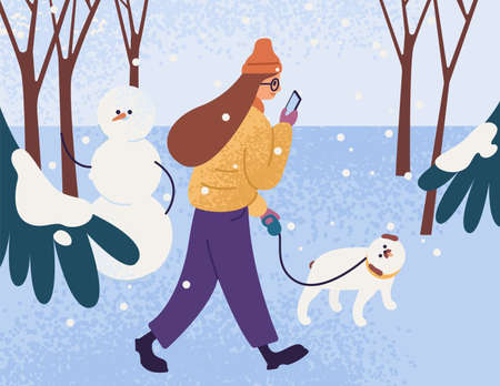 Young woman in warm outerwear walking dog in park and looking in smartphone. Female character with pet in winter forest. Person walk in snowy weather. Vector flat cartoon illustration.