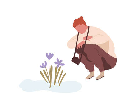 Squatting man admiring first spring flower or snowdrop. Teenager with camera sitting and looking at primrose. Flat vector cartoon illustration isolated on white background