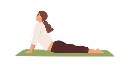 Woman practicing Hatha yoga on mat vector flat illustration. Active female character demonstrating cobra or upward facing dog pose isolated on white. Sportswoman doing backbend, enjoying training Ilustração