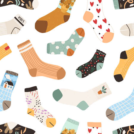 Seamless texture with cute cotton and woolen socks with different drawings, patterns and designs isolated on white background. Endless backdrop with warm garments. Colored flat vector illustration Ilustração